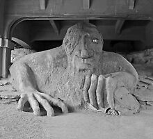 The Fremont Troll & his dinner  by Cody  VanDyke