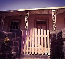 Old house with bluestone fence and pink gate by visualimagery