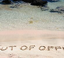 OUT OF OFFICE written on sand on a beautiful beach, blue waves in background by Stanciuc