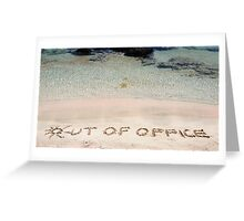 OUT OF OFFICE written on sand on a beautiful beach, blue waves in background Greeting Card