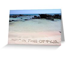 NOT IN THE OFFICE written on sand on a beautiful beach, blue waves in background Greeting Card