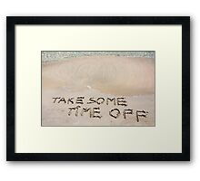 TAKE SOME TIME OFF written on sand on a beautiful beach, blue waves in background Framed Print