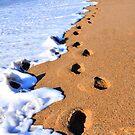 Footprints in the sand... by Poete100