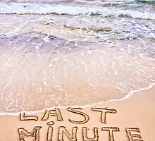 Last Minute written on sand, being washed away by waves by Stanciuc