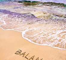 Word BALANCE written on sand, with sea waves in background by Stanciuc