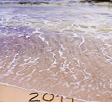 New Year 2015 is coming concept - inscription 2014 and 2015 on a beach sand, the wave is covering 2014 by Stanciuc