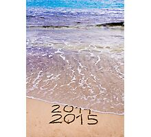 New Year 2015 is coming concept - inscription 2014 and 2015 on a beach sand, the wave is covering 2014 Photographic Print