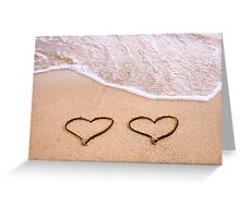 Two hearts drawn in the sand on a beautiful beach Greeting Card