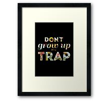 Don't grow up, it's a trap. Framed Print