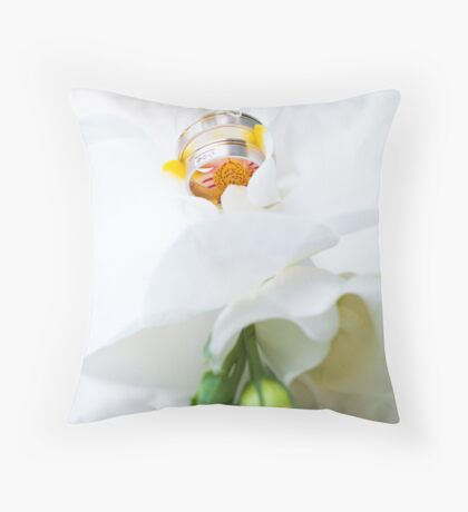 Close up on flower arrangment with white orchid and wedding rings Throw Pillow
