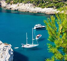 View of Cala Galdana with yachts on turquoise sea water, Menorca, Balearic Islands, Spain by Stanciuc