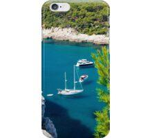 View of Cala Galdana with yachts on turquoise sea water, Menorca, Balearic Islands, Spain iPhone Case/Skin
