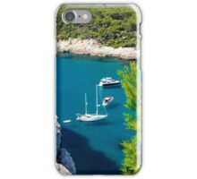 View of Cala Galdana with yachts on turquoise sea water, Menorca, Balearic Islands, Spain iPhone Case/Skin
