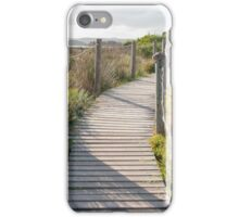 Wooden path crossing grass field in summer iPhone Case/Skin