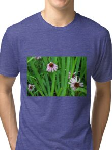 Pink large flowers in the grass. Tri-blend T-Shirt
