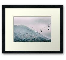 Cable car on a misty mountain high up Framed Print