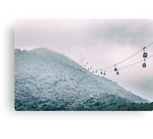Cable car on a misty mountain high up Canvas Print