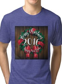 Merry Christmas and Happy New Year 2016 wreath on wood  Tri-blend T-Shirt