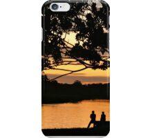 The sunset glows on Puerto Narino, Amazon River iPhone Case/Skin