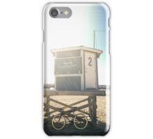 Bike leaning against lifeguard hut on beach iPhone Case/Skin