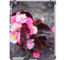 Small pink flowers on dry land. iPad Case/Skin