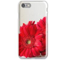 Red gerberas on white table iPhone Case/Skin