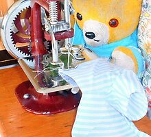 Fred Bear mends his torn shirt by missmoneypenny