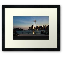 Sailing ship in front of the financial district Framed Print