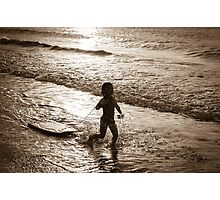 Little surfer girl runs in the waves Photographic Print