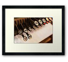 Antique cash register keys Framed Print