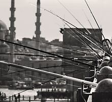 Fishing & thinking on Galata bridge by Hercules Milas