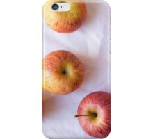 Red apples on white tablecloth iPhone Case/Skin