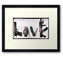 LOVE GUNS  Framed Print