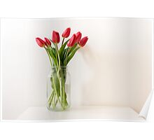 Red tulips in tall glass jar Poster