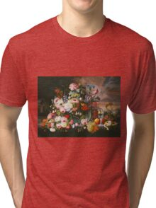 Severin Roesen - Still Life Of Flowers And Fruit With A River Landscape In The Distance. Still life with flowers: bouquet, bumblebee , carnations, peonies, roses, tulips, marigolds, garden, blossom Tri-blend T-Shirt