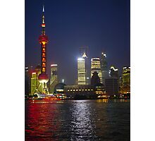 A view of the Pudong pearl tower and skyline at night; Changhai, China Photographic Print