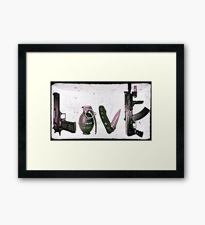 'LOVE' GUNS  Framed Print