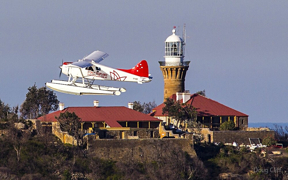 Sydney Seaplanes in front of Palm Beach Lighthouse by Doug Cliff
