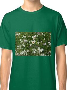 Natural pattern with white small flowers in the grass. Classic T-Shirt