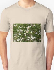 Natural pattern with white small flowers in the grass. Unisex T-Shirt