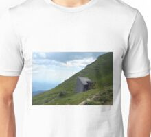 Abandoned house in the mountains with cloudy sky. Unisex T-Shirt