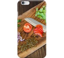 Freshly cut vegetables on a cutting board with a chef's knife  iPhone Case/Skin