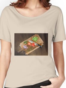 Freshly cut vegetables on a cutting board with a chef's knife  Women's Relaxed Fit T-Shirt