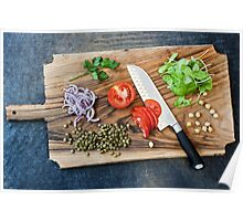 Freshly cut vegetables on a cutting board with a chef's knife  Poster