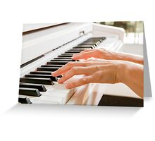 fingers and hands of a woman playing a white piano  Greeting Card