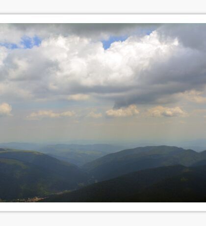 Natural scenery with mountains and cloudy sky. Sticker