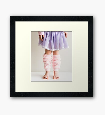 Little girl in pink leg warmers Framed Print