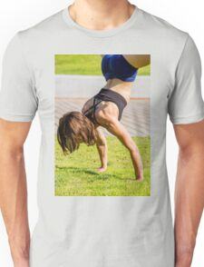 Young female bodybuilder exercises outdoors in a park Unisex T-Shirt