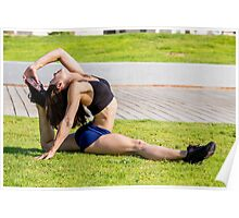 Young female bodybuilder exercises outdoors in a park Poster