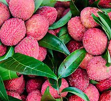 Close-up of red fresh Lychee fruits in Thailand market by Stanciuc